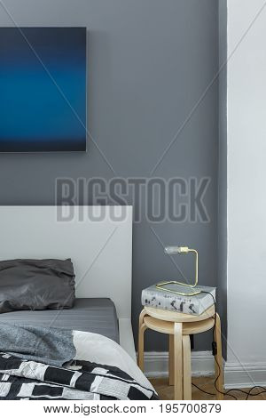 Bedroom With Wooden Side Table