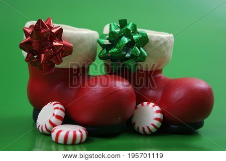 Santa's boots with peppermints and red and green bows