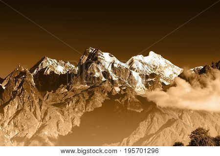 From left - Mount South Kabru (24215 feet) Mount North Kabru and Mount Talung (24200 feet) - beautiful view of Himalayan mountains at Ravangla Sikkim. Himalaya is the great mountain range in Asia . Tinted image.