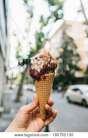 Female hand with ice cream. Delicious food, dessert