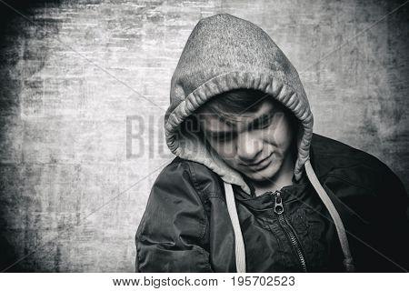 Sad teenager boy close-up
