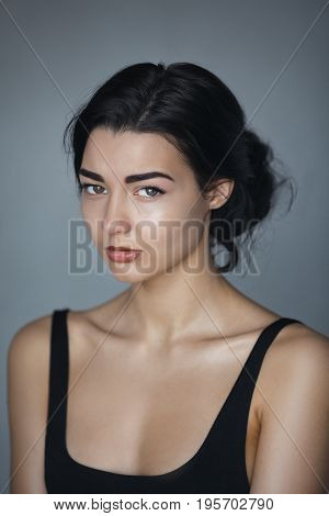 Crying Beauty Girl. Beautiful Woman Cry. Tears. Cool young modern mixed race Asian Caucasian female model against gray background
