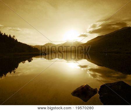 Beautiful mountain lake at sunset - sepia toned