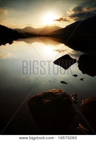 Beautiful mountain lake at sunset