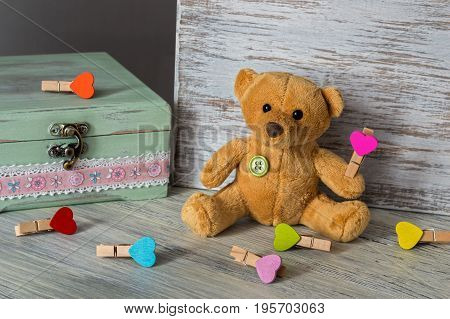 Soft toy bear with multi-colored toys. Festive Greeting Card for Valentine's Day