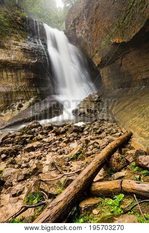 Miners Falls at Pictured Rocks National Lakeshore - Upper Peninsula of Michigan. Miners Falls cascades over rock face and rushes over moss covered boulders on its path to Lake Superior.