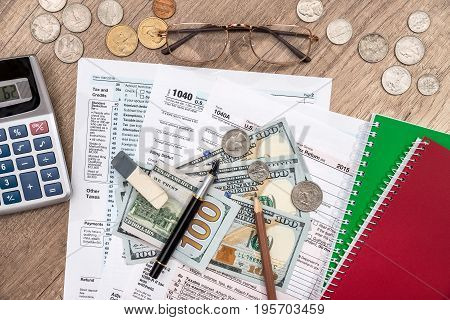 1040 Tax Form, Dollar Banknote And Coin, Glasses, Pencil, Pen
