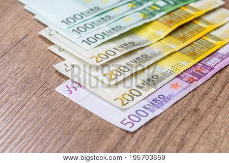 100 200 500 Euro Banknote On Wooden Desk