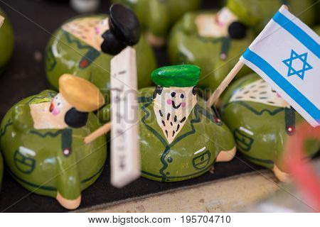 funny souvenir israeli soldier figures for sale at handicraft market. Israel