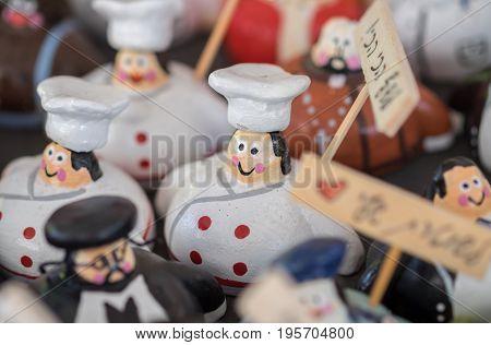 Souvenir figures of cooks for sale at handicraft market. Israel