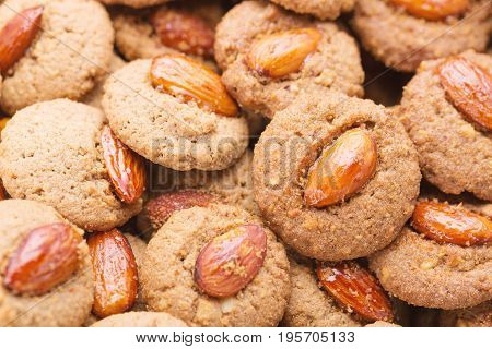 Crispy cookies with almond as a background close up. Selective focus.