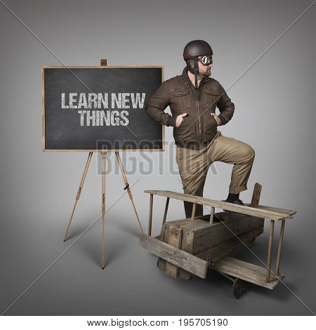 Take it easy dude text on  blackboard with businessman and wooden plane