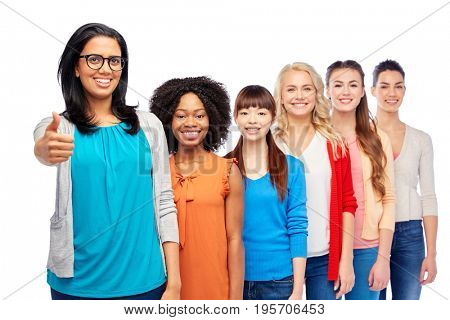 diversity, race, ethnicity, gesture and people concept - international group of happy smiling different women over white showing thumbs up