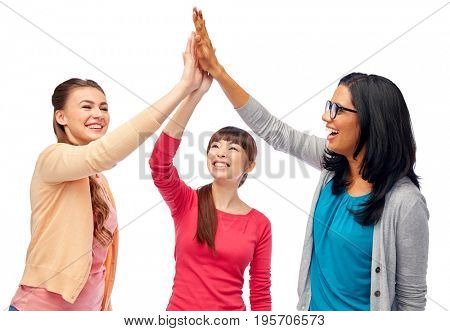 diversity, race, ethnicity and people concept - international group of happy smiling different women over white doing high five