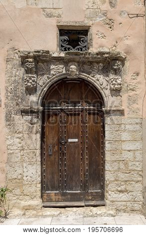 Old typical wooden door in Provence France