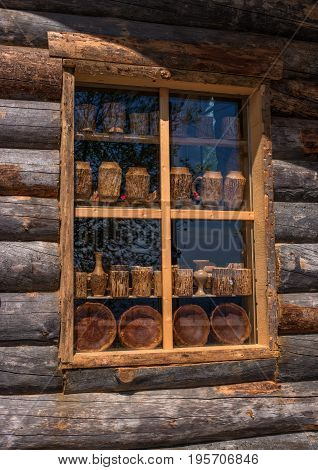 Sortavala, Republic of Karelia, Russia - June 12, 2017: Window souvenir shop in a wooden house of logs. In the same house there is the Museum of Ladoga.