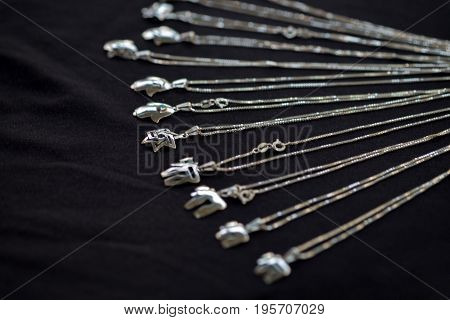 Jewish theme silver jewelry on black background