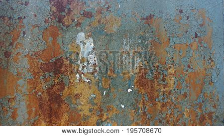 Corroded metal background. Rusted white painted metal wall. Rusty metal background with streaks of rust. Rust stains. The metal surface rusted spots. Rystycorrosion. poster