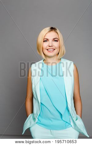 Smiling girl in blue suit