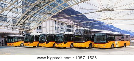 Chur, Switzerland - 3 March, 2017: Post Buses at the Chur bus station. Post Bus Switzerland (German: PostAuto Schweiz) is a subsidiary company of the Swiss Post, it provides regional and rural bus services throughout Switzerland.