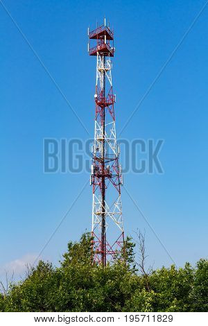 Telecommunication Tower On A Blue Sky Background
