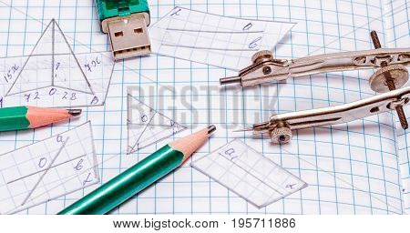 Compasses flash drive pencils and cut out geometric shapes tools for writing drawing and acquiring knowledge and new skills