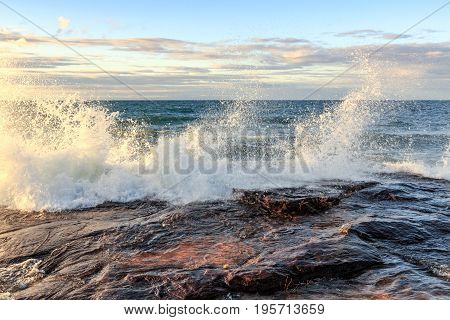 Storm surge drives crashing waves over sandstone rock at Pictured Rocks National Lakeshore in the Upper Peninsula of Michigan in Munising