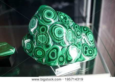 Green Beautiful Strange Mineral With Hypnotic Spiral Shapes In A Museum