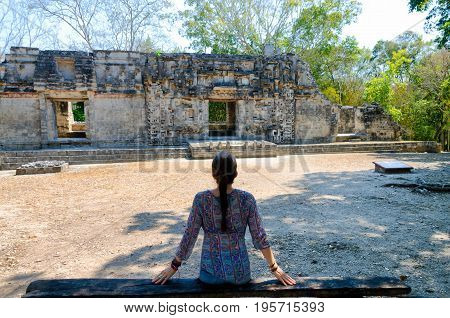 Woman and Ancient Mayan temple in Chicanna Mexico
