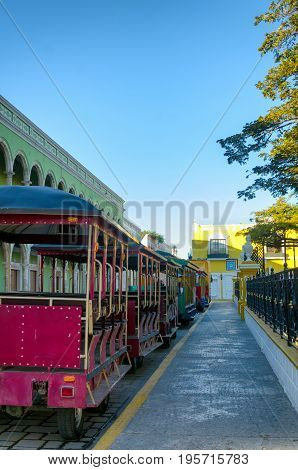 View of tourist trolley in main square in Campeche Mexico