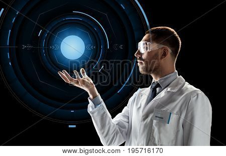 science, future technology and people concept - male doctor or scientist in white lab coat and safety glasses over black background with virtual projection