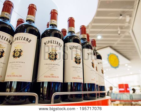 June 18 2017. Close-up detail of multiple bottles of Italian red wine on the shelves of a duty free shop. Frankfurt Airport Germany. Travel and shopping editorial concept.