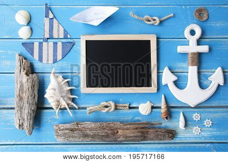 Flat Lay Of Chalkboard On Blue Wooden Background. Nautic Or Maritime Summer Decoration As Holiday Greeting Card. Copy Space For Advertisement Or Free Text