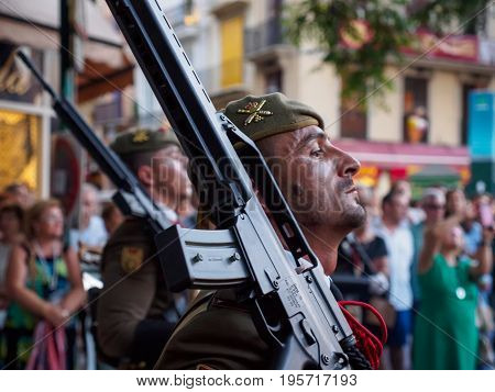 June 19 2017. A soldier of the Spanish Army marches with his rifle shouldered during the parade of the Christian celebration of Corpus Christi. Celebration and military editorial concept.