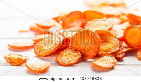 Dried vegetables chips from carrot. Organic diet and vegan food.