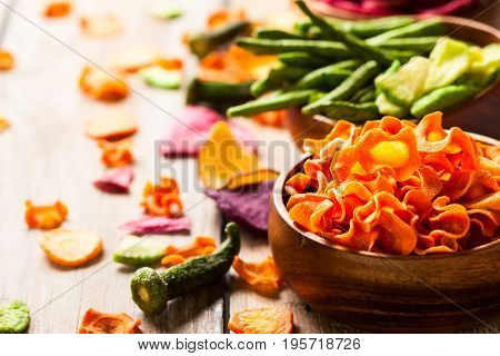 Dried vegetables chips from carrot, beet, parsnip and other vegetables . Organic diet and vegan food.