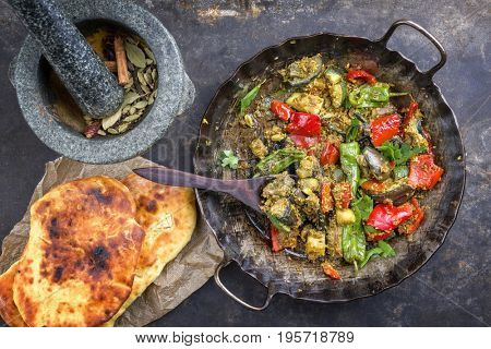 Indian Vegetable Curry Fry with Pita Bread as close-up in a in a frying pan