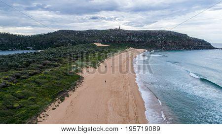 Aerial view of Palm Beach Sydney Australia with Barrenjoey lighthouse atop headland