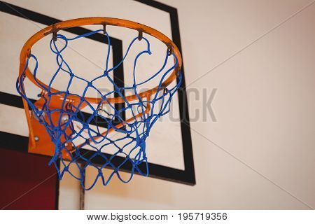 Low angle view of blue basket ball hoop in court