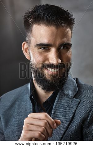 Happy modern businessman smiling, portrait.