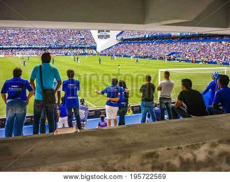 GUAYAQUIL, ECUADOR, NOVEMBER - 2016 - Crowded grandstand at soccer match between Emelec against Liga de Quito playing at the George Capwell Stadium in Guayaquil city Ecuador.