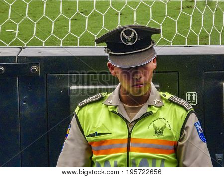 GUAYAQUIL, ECUADOR, NOVEMBER - 2016 - Policeman at soccer match between Emelec against Liga de Quito playing at the George Capwell Stadium in Guayaquil city Ecuador.