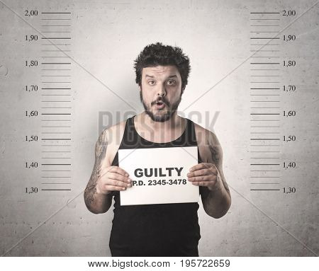 Caught guilty man with ID signs on his hand. poster