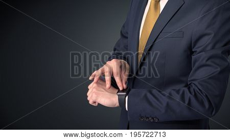 Man wearing suit with smartwatch on his wrist.