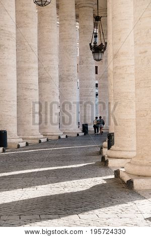 Rome Italy - August 19 2016: Colonnade in St Peters Square. The square is located directly in front of St. Peter's Basilica in the Vatican City and was designed by Bernini