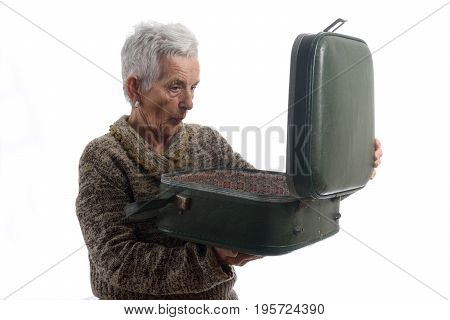 Surprised Senior Woman Opening A Vintage Suitcase