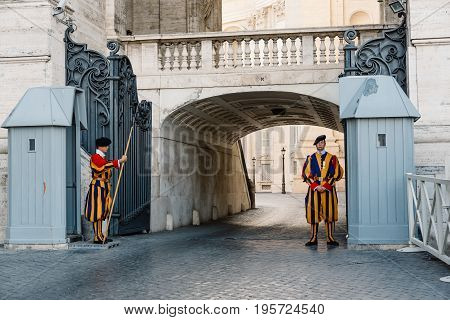 Rome Italy - August 19 2016: Papal Swiss guards standing at his post. The Swiss guards served since the late 15th century.