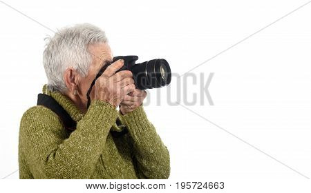 Senior Woman Shooting With A Camera Reflex