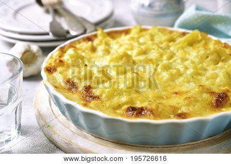 Cauliflower Casserole With Cheese And Milk Sauce.