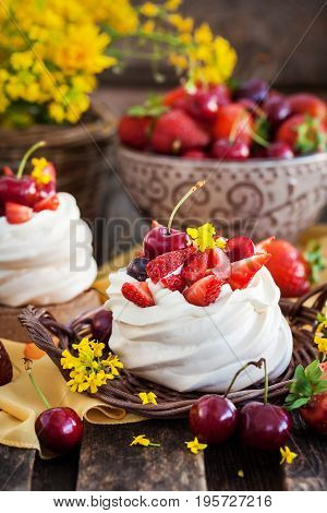 Delicious Mini Pavlova Meringue Cake Decorated With Fresh Berries